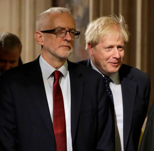 Britain's Prime Minister Boris Johnson and opposition Labour Party Leader Jeremy Corbyn walk through the Commons Members Lobby in Parliament, London, Britain, October 14, 2019.