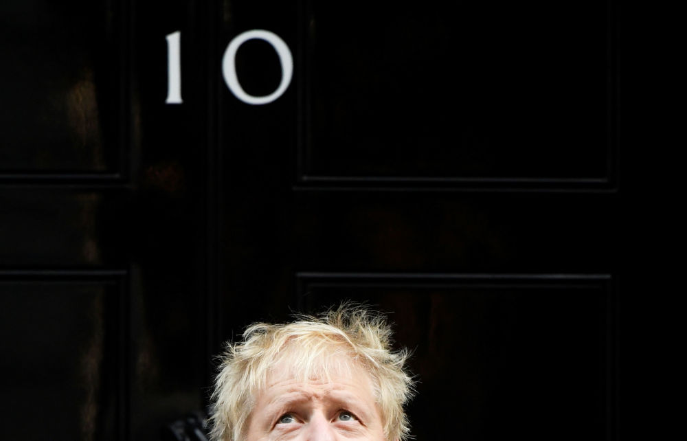 Britain's Prime Minister Boris Johnson reacts as he poses for a photo during a meeting with fundraisers for the Royal British Legion outside Downing Street in London, Britain October 28, 2019.