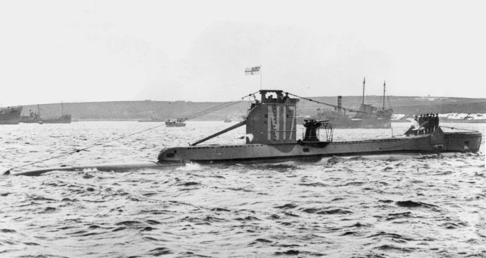 HMS Urge under way in harbour, at harbour stations