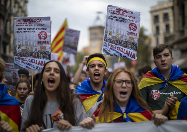 Students protest during a demonstration in Barcelona, Spain, Thursday, Oct. 31, 2019. Hundreds of young people decided to set up camp after Spain's Supreme Court convicted 12 separatist leaders of illegally promoting Catalonia region's independence and sentenced nine of them to prison.