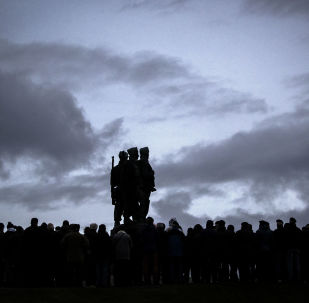Serving servicemen and veterans gather at the Commando Memorial at Spean Bridge, for the annual Remembrance Sunday ceremony, near Fort William, in Scotland, Sunday, Nov. 10, 2019.