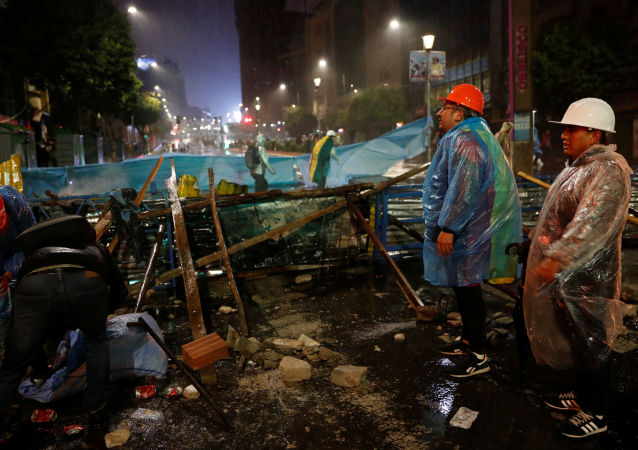 Demonstrators build a barricade during a protest against Bolivia's President Evo Morales in La Paz, Bolivia, 10 November 2019
