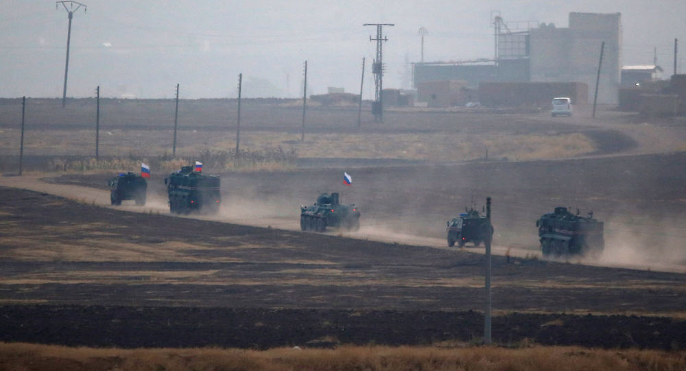 Russian military vehicles return following a joint Turkish-Russian patrol in northeast Syria, as they are pictured near the Turkish border town of Kiziltepe in Mardin province, Turkey, November 1, 2019