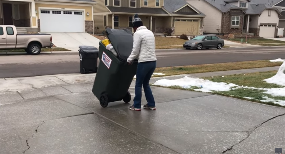 Slick Colorado Woman Uses Icy Driveway to Slide Trash Can