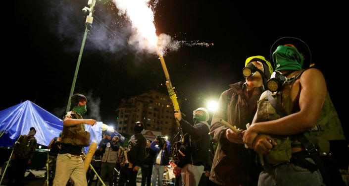 Members of Youth Resistance Cochala set off fireworks to celebrate after Bolivian Senator Jeanine Anez became interim president, following Bolivia's former President Evo Morales' departure from the country, in Cochabanba, Bolivia November 12, 2019