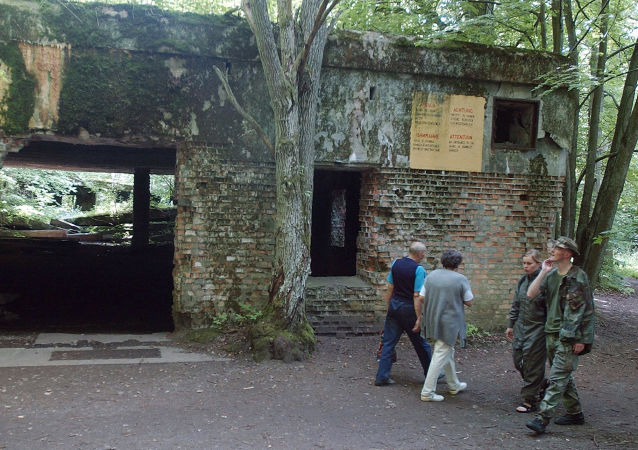 In this July 17, 2004 file photo tourists visit the ruins of Adolf Hitler's headquarters the Wolf's Lair in Gierloz, northeastern Poland, where his chief of staff members made an unsuccessful attempt at Hitler's life on July 20, 1944. Margot Woelk was one of 15 young women who sampled Hitler's food to make sure it wasn't poisoned before it was served to the Nazi leader in his Wolf's Lair, the heavily guarded command center in what is now Poland, where he spent much of his time in the final years of World War II. Margot Woelk kept her secret hidden from the world, even from her husband then, a few months after her 95th birthday, she revealed the truth about her wartime role.