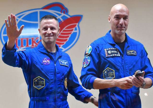 International Space Station (ISS) Expedition 60-61 crew members NASA astronaut Andrew Morgan of the United States and ESA astronaut Luca Parmitano of Italy attend their final news conference ahead of their launch to the ISS at the Baikonur Cosmodrome, Kazakhstan