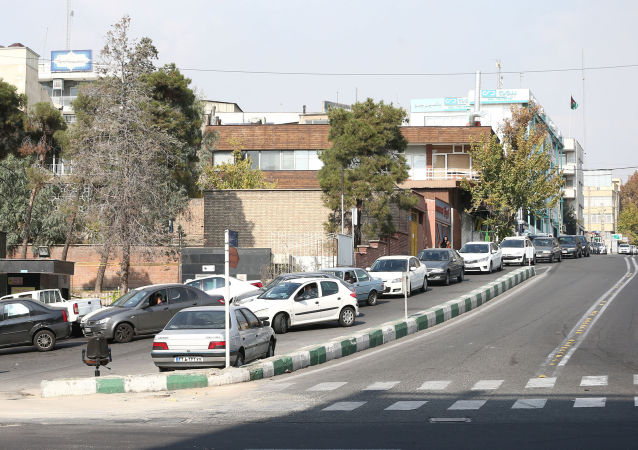 Cars queue at a petrol station after the fuel price increased in Tehran, Iran