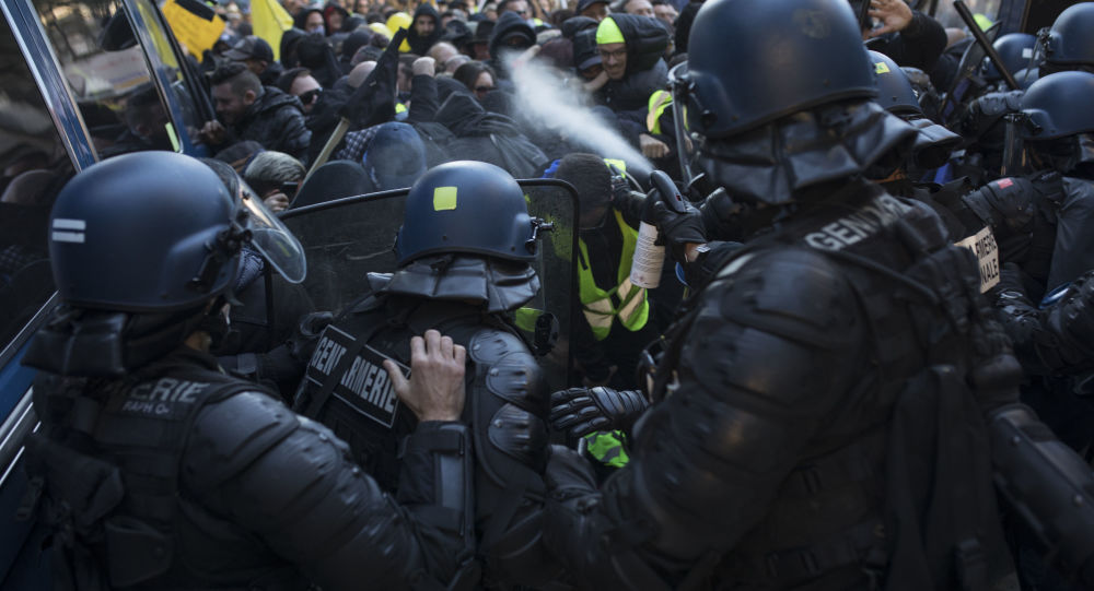 Police use pepper spray during a yellow vest demonstration marking the one year anniversary of the movement in Marseille, southern France, Saturday, 16 November, 2019.
