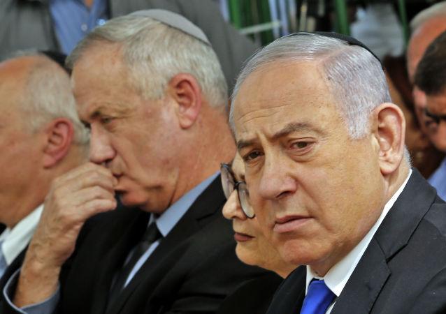 Israeli Prime Minister Benjamin Netanyahu (R), Israeli president of the Supreme Court  Esther Hayut (C) and Benny Gantz (L), leader of Blue and White party, attend a memorial ceremony for late Israeli president Shimon Peres, at Mount Herzl in Jerusalem on September 19, 2019