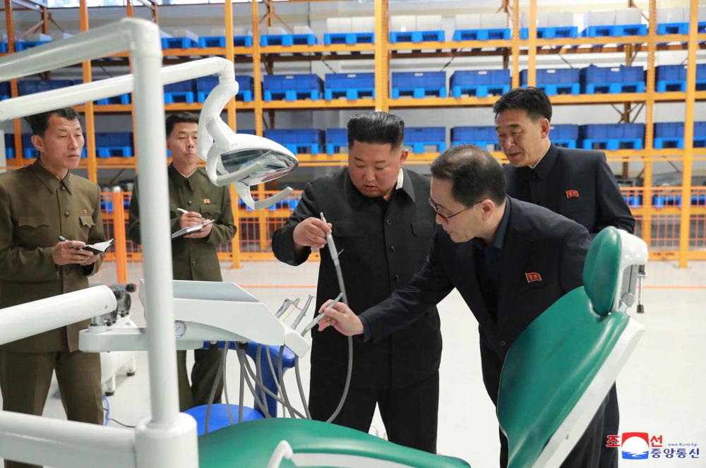 North Korean leader Kim Jong Un inspects the Myohyangsan Medical Appliances Factory