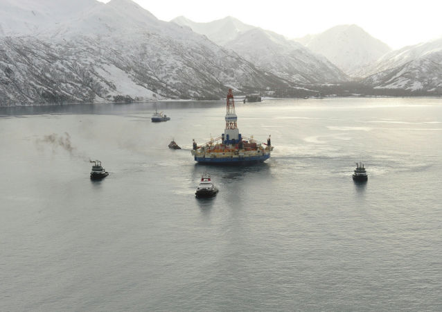 US Coast Guard tugs tow  the Royal Dutch Shell conical drilling unit Kulluk from Kiliuda Bay near Kodiak Island, Alaska, Feb. 26, 2013