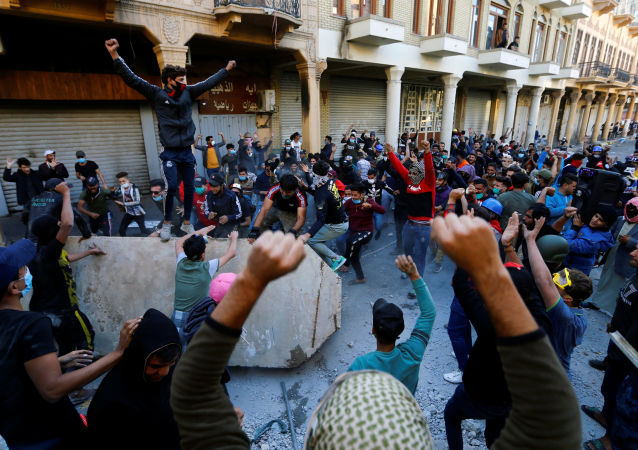 Iraqi demonstrators take part in ongoing anti-government protests in Baghdad, Iraq November 21, 2019