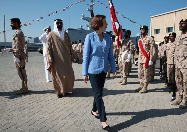 French Defence Minister Florence Parly and United Arab Emirates' Minister of State for Defence Mohammed Bin Ahmad al-Bawardi inspect members of an honour guard during a military ceremony at the French Naval Base in Abu Dhabi, United Arab Emirates November 24, 2019