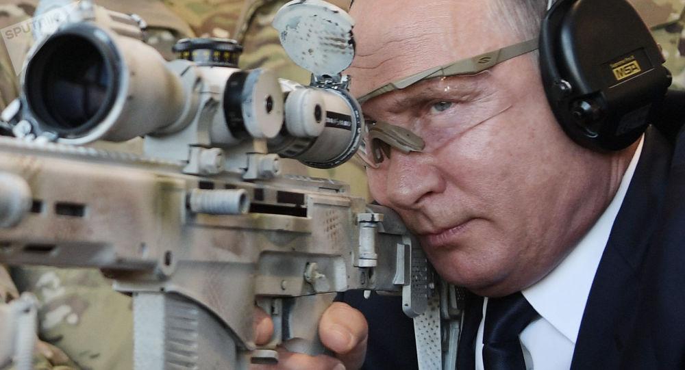 September 19, 2018. Russian President Vladimir Putin is shooting from a Chukavin sniper rifle (SVCh 380) at the Kalashnikov Concern shooting club at Patriot military patriotic park