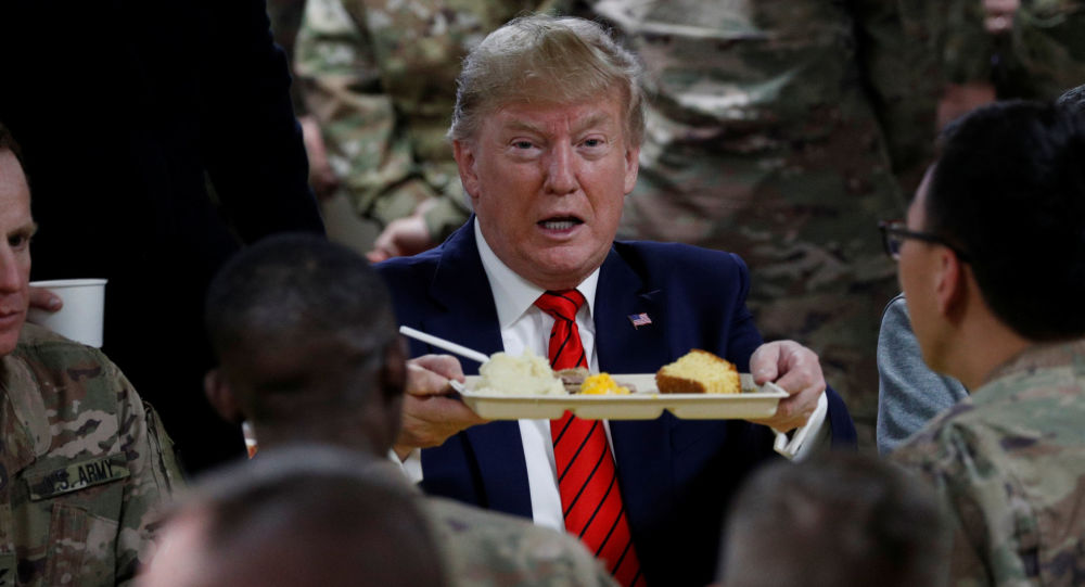 U.S. President Donald Trump eats dinner with U.S. troops at a Thanksgiving dinner event during a surprise visit at Bagram Air Base in Afghanistan, November 28, 2019