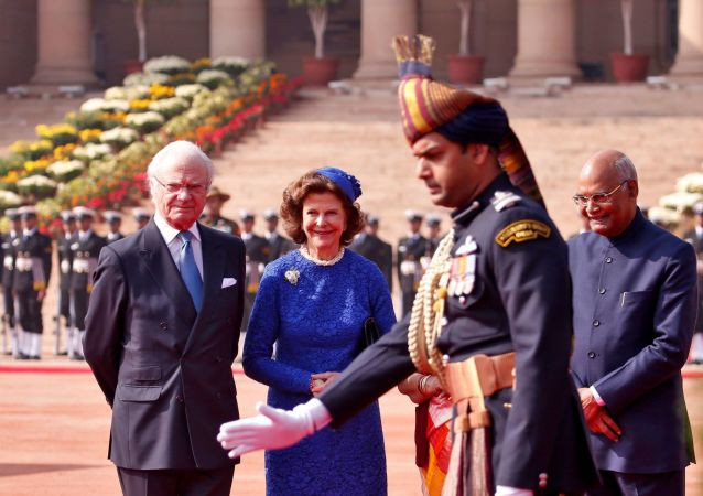 Sweden's King Carl XVI Gustaf, Queen Silvia and India's President Ram Nath Kovind stand during a ceremonial reception at the forecourt of Rashtrapati Bhavan presidential palace in New Delhi, India December 2, 2019
