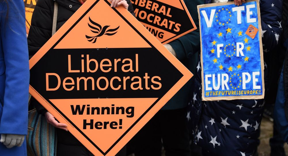 Supporters wait for the arrival of Britain's opposition Liberal Democrats leader Jo Swinson for a general election campaign visit to an eco home building site in Sheffield, north England on November 22, 2019