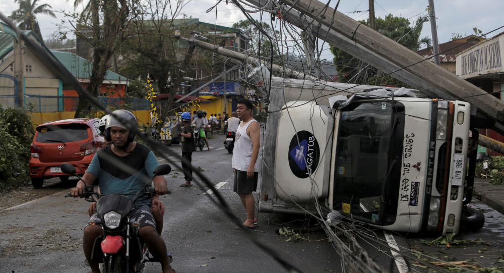 Residents are seen after Typhoon Kammuri hit Camalig town, Philippines, December 3, 2019