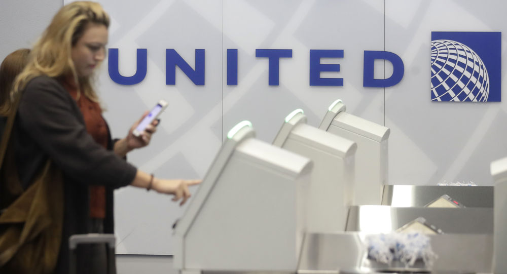A woman uses a United Airlines kiosk at San Francisco International Airport in San Francisco, Tuesday, Nov. 26, 2019.