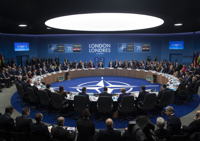NATO Secretary General Jens Stoltenberg makes an opening statement during a plenary session at the NATO summit at The Grove, Wednesday, Dec. 4, 2019, in Watford, England