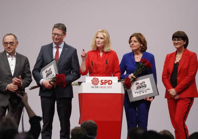 Germany's social democratic SPD party co-leader Norbert Walter-Borjans, SPD member Thorsten Schaefer-Guembel, Mecklenburg-Western Pomerania's state premier SPD Manuela Schwesig, outgoing Interim leader of Germany's social democratic SPD party Malu Dreyer and Germany's social democratic SPD party co-leader Saskia Esken stand on stage after new co-leaders have been elected during the party congress of Germany's Social Democrats (SPD) at the fairgrounds in Berlin, on December 6, 2019.