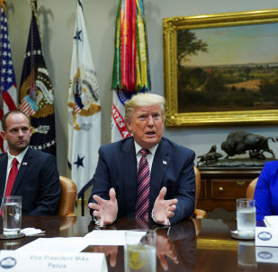 President Donald Trump speaks while sitting between Ryan Newby, Vice President of the Bank of Laverne and Barb Smith, the President of  Journey Steel, while participating in a roundtable on small business and red tape reduction accomplishments in the Roosevelt Room at the White House in Washington, U.S. December 6, 2019.