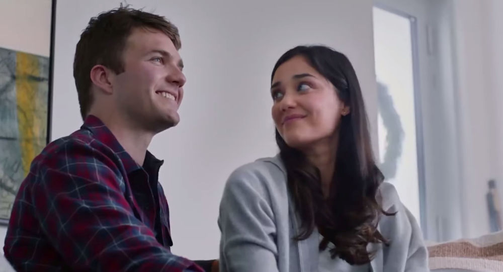 Actors are pictured in this screengrab from The Gift That Gives Back exercise bike commercial by Peloton obtained December 4, 2019.