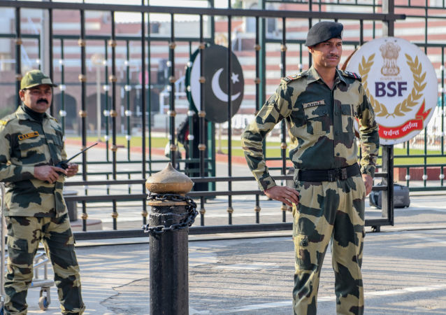 Border Security Force (BSF) personnel stand guard at the India-Pakistan Wagah Border about 35 kms from Amritsar on December 4, 2019
