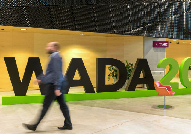 A man walks at the World Anti-Doping Agency (WADA) venue on the eve of the Fifth World Conference on Doping in Sport in Katowice, Poland, November 4, 2019.