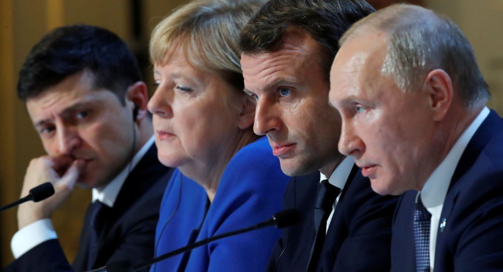 Ukraine's President Volodymyr Zelenskiy, German Chancellor Angela Merkel, French President Emmanuel Macron and Russia's President Vladimir Putin attend a press conference after a summit on Ukraine at the Elysee Palace, in Paris, on December 9, 2019