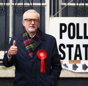 Britain's opposition Labour Party leader Jeremy Corbyn poses outside a polling station after voting in the general election in London, Britain, December 12, 2019