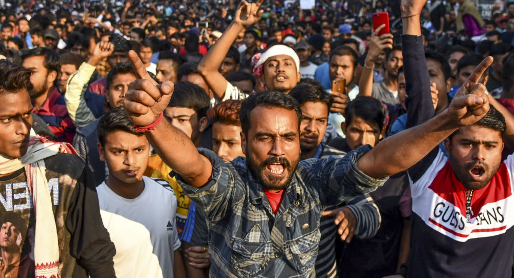Demonstrators shout slogans during a protest against Citizenship (Amendment) Bill in Guwahati on December 12, 2019.