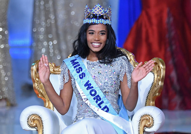 Newly crowned Miss World 2019 Miss Jamaica Toni-Ann Singh smiles during the Miss World Final 2019 at the Excel arena in east London on December 14, 2019.