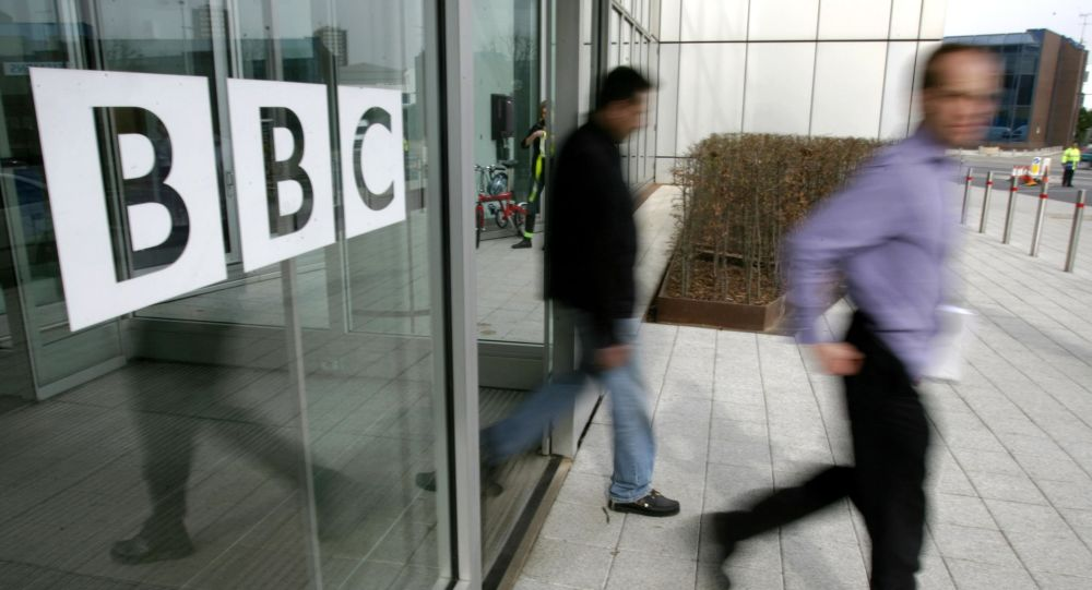 People leave the BBC building, in the corporation's West London headquarters (File)