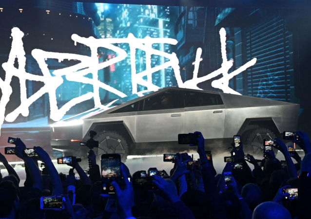 Nov 21, 2019;  Hawthorne, CA, U.S.A; The Tesla Cybertruck takes the stage at an unveiling of the long awaited pickup truck from the company at the TeslaDesign Studio in Hawthorne, Calif.