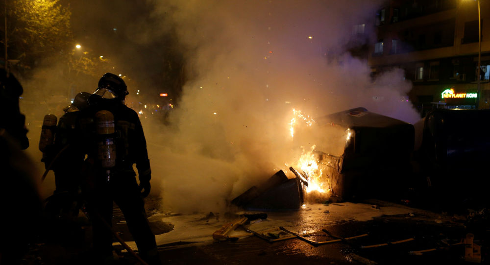 FC Barcelona v Real Madrid - Barcelona, Spain - December 18, 2019  Firefighters respond to a fire as protestors gather in Barcelona during the football match between FC Barcelona and Real Madrid