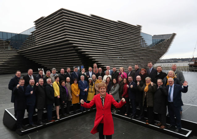 Scotland's First Minister Nicola Sturgeon poses for a photograph with newly elected SNP MP's in front of the V&A Museum in Dundee, Scotland, Britain December 14, 2019