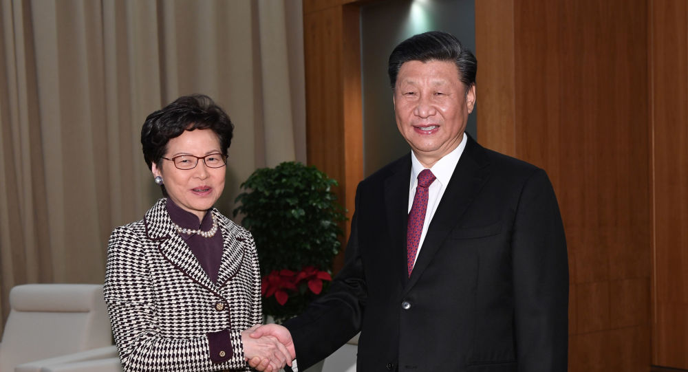 Chinese President Xi Jinping shakes hands with Hong Kong Chief Executive Carrie Lam, during their meeting on the eve of the 20th anniversary of the former Portuguese colony's return to China, in Macau, China December 19, 2019.