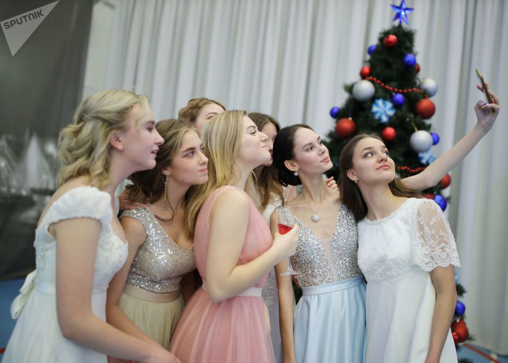 Girls are photographed during the New Year's ball at the Krasnodar Presidential Cadet School in Krasnodar, Russia.