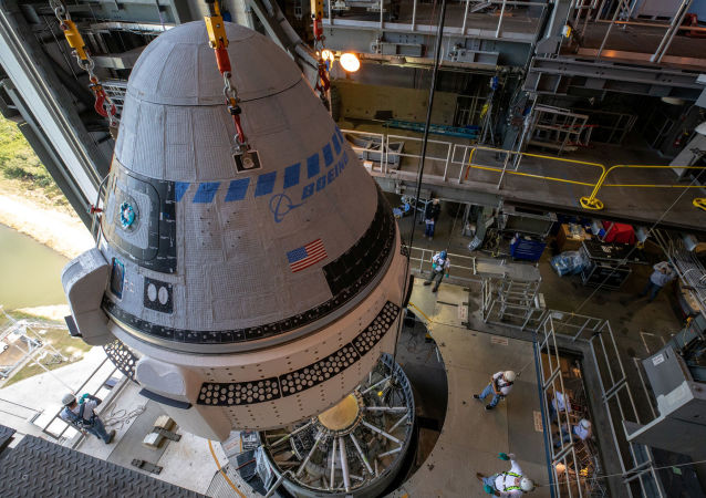 The Boeing CST-100 Starliner spacecraft is guided into position above a United Launch Alliance Atlas V rocket at the Vertical Integration Facility at Space Launch Complex 41 at Cape Canaveral Air Force Station, Florida, U.S. November 21, 2019.