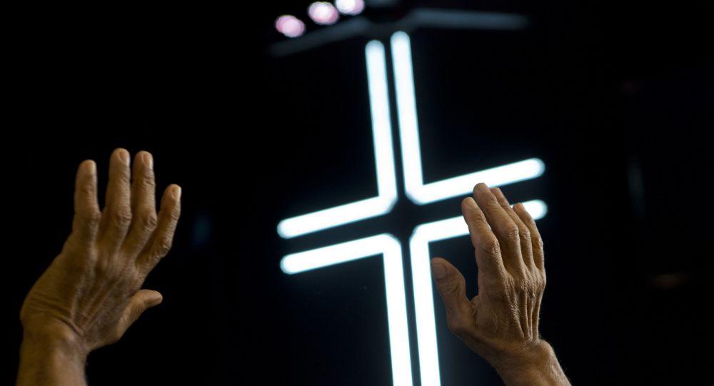 An evangelical prays during a Mass at a church in Havana, Cuba, Sunday, Jan. 27, 2019.