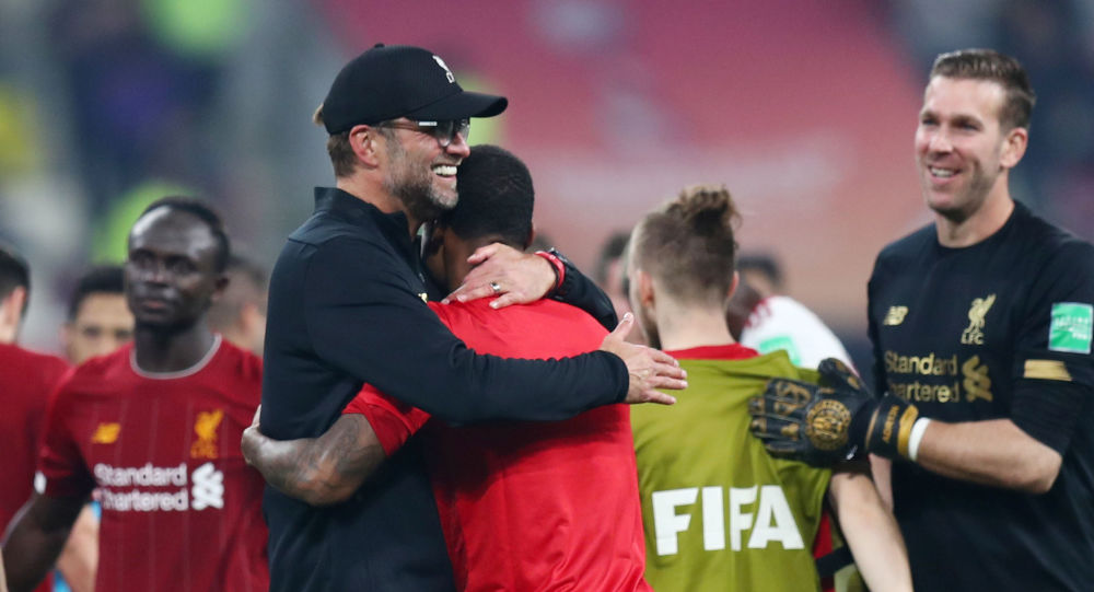 Club World Cup - Final - Liverpool v Flamengo - Khalifa International Stadium, Doha, Qatar - December 21, 2019  Liverpool manager Juergen Klopp and his players celebrate winning the Club World Cup