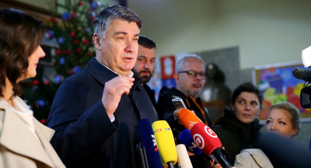 Presidential candidate Zoran Milanovic talks to the media after casting his ballot at a polling station during the presidential election in Zagreb, Croatia December 22, 2019.