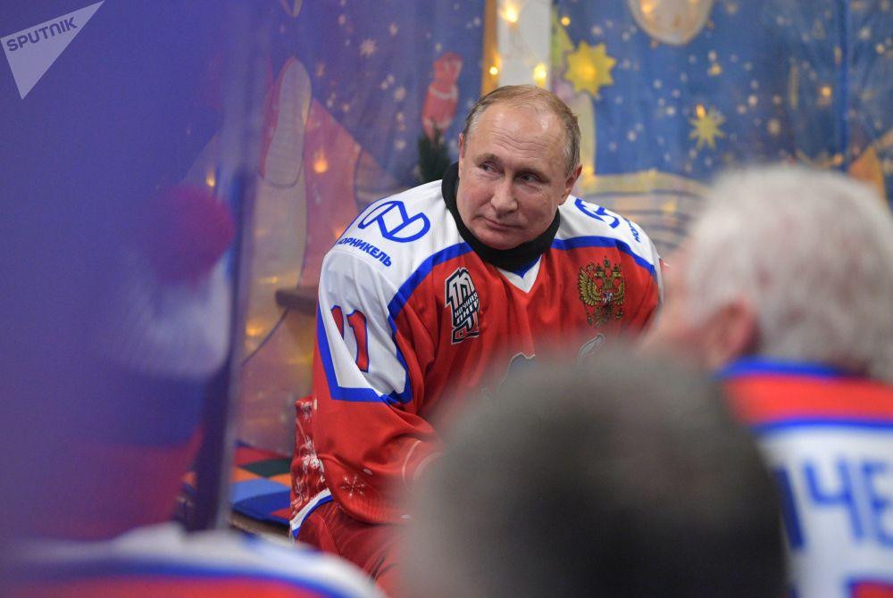 Russian President Vladimir Putin during a break in the exhibition match of the Night Hockey League on the Red Square skating rink.