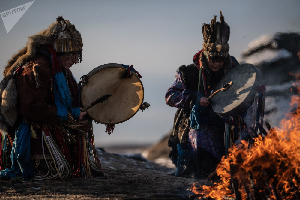 Shamans perform a ritual near the Bolshiye Allaki lake in Russia's Chelyabinsk region