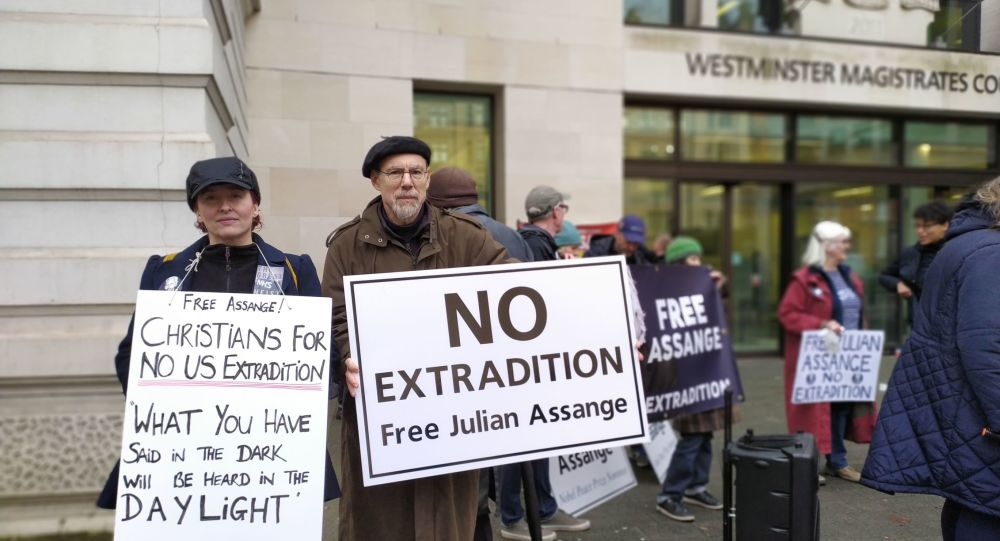 Two supporters of Julian Assange outside of the Westminster Magistrates Court 18 December 2019