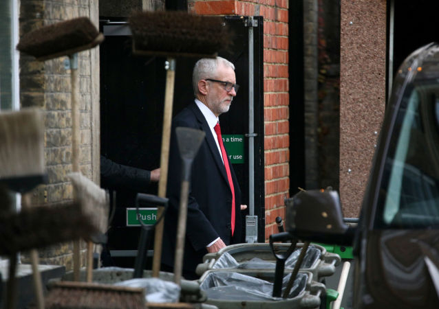 Britain's opposition Labour Party leader Jeremy Corbyn leaves Islington Town Hall through the backdoor after a meeting following the results of the general election in London, Britain, December 13, 2019