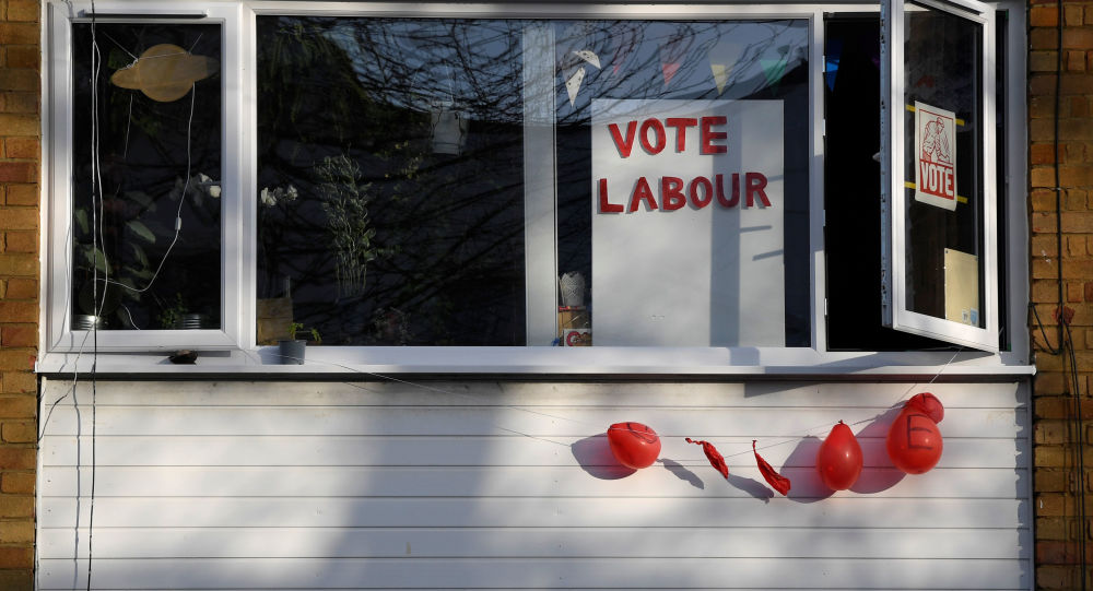 Political election campaign messages and burst balloons are seen in at a house in the same street where Labour party leader Jeremy Corbyn lives, in London, Britain, December 14, 2019.