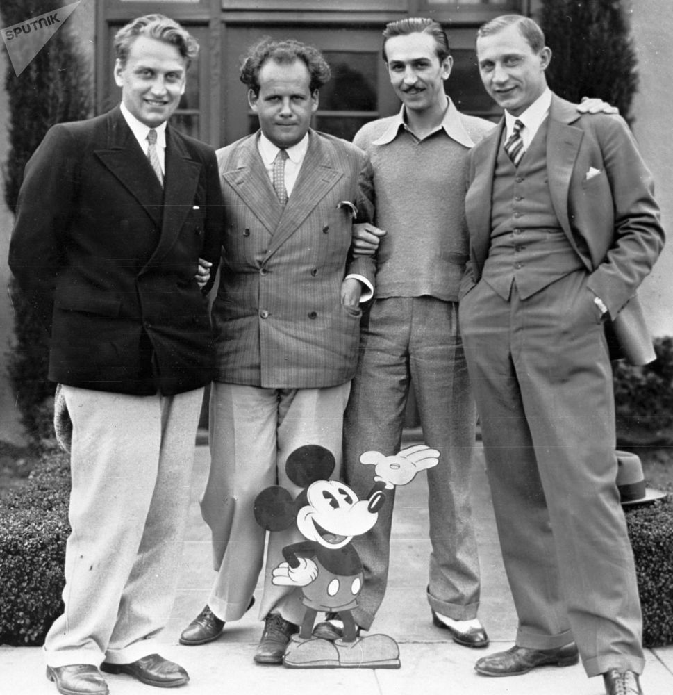 From left to right: Soviet Film directors Grigory Aleksandrov and Sergey Eisenstein, US cartoonist Walt Disney and Soviet cinematographer Eduard Tisse.